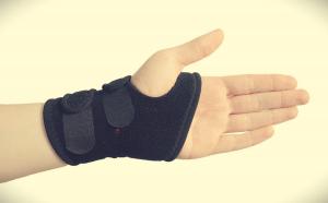 left hand with wrist brace